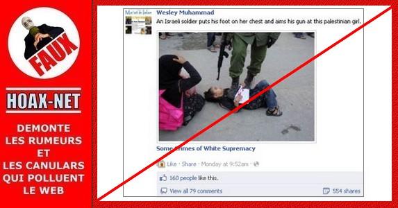 NON, ce ne sont pas un soldat israélien et une petite fille palestinienne sur cette photo !